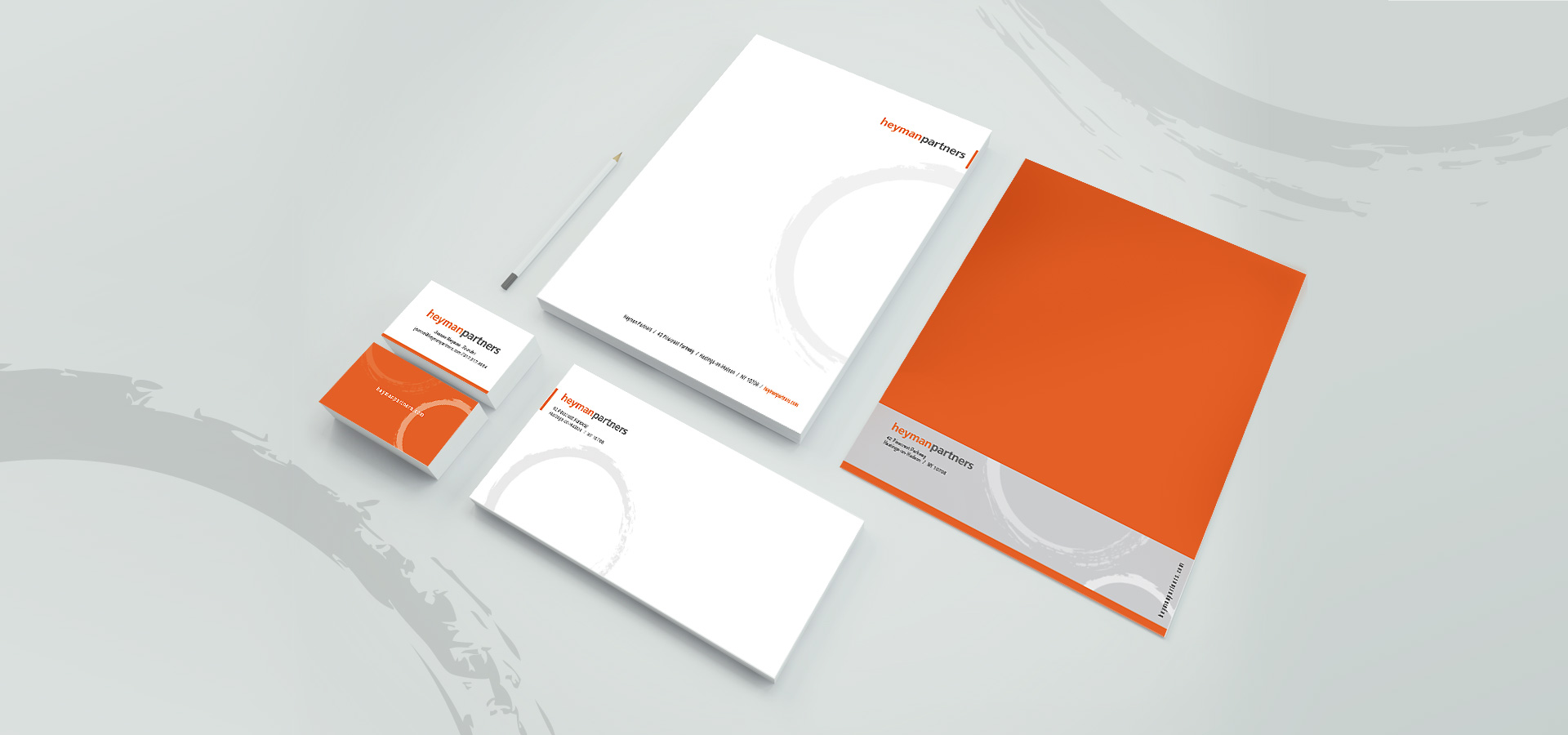 orange and gray tone stationery design including business card, letterhead, envelope and business folder for heyman partners